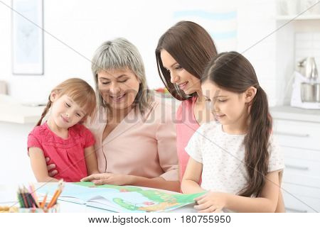 Family with book sitting at kitchen table