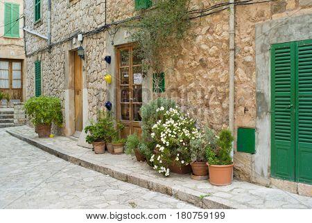 VALLDEMOSSA, SPAIN - MARCH, 2017: Idyllic street scene in Valldemossa on Mallorca island