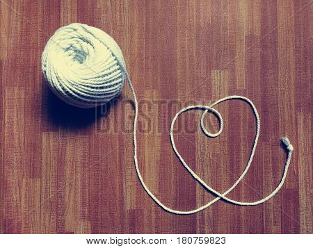 Heart made of white thread