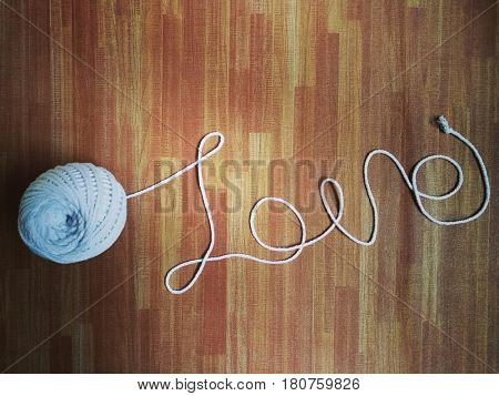 Love, made of white thread