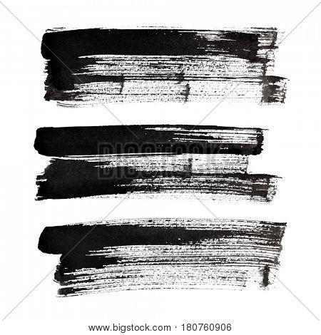 Set of black brush strokes isolated on the white background
