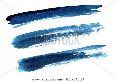 Set of blue ink brush strokes isolated on the white background