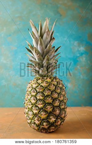 Pineapple. Pineapple on green abstract background. Fruit photo concept. Summer photo concept. Copyspase