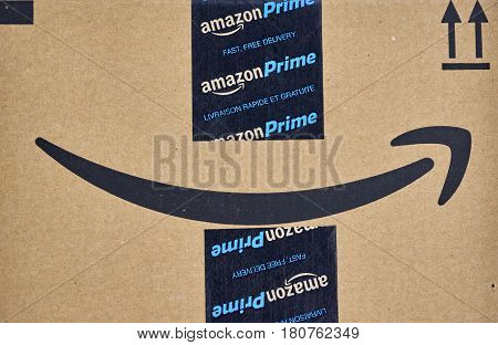 MONTREAL CANADA - MARCH 28 2017: Amazon Prime shipping box with branded tape on it. Amazon is an American electronic commerce and cloud computing company.