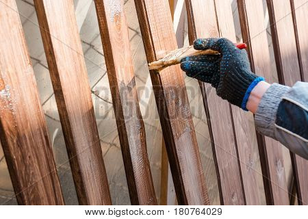 To Paint A Fence. The Man Paints A Fence.