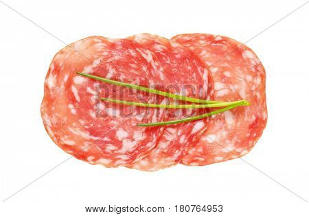 thin slices of dry salami and chives on white background
