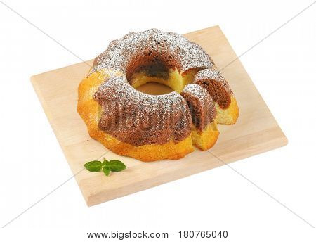marble bundt cake on cutting board, two slices cut off