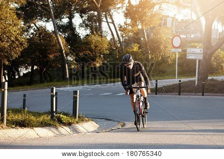 Sports, Extreme And Active Lifestyle. Outdoor Shot Of Self-determined Confident Young Rider With Fit