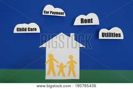 Family of three paper cutout figures with monthly bills cloud items