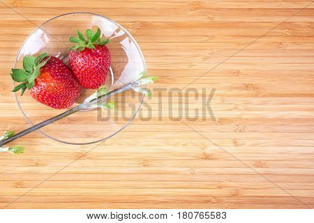 fresh ripe strawberries on the wooden table