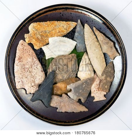 Plate full of real American indian arrowheads found in Texas and Missouri made around 7000 to 8000 years ago.