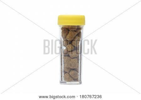 Herbal lozenge in a plastic bottle isolated