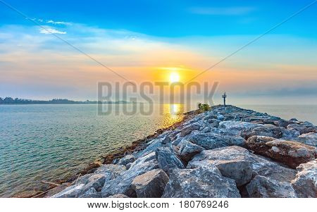 calmness seashore in morning sunrise with warning tower at Rayong Province Eastern of Thailand