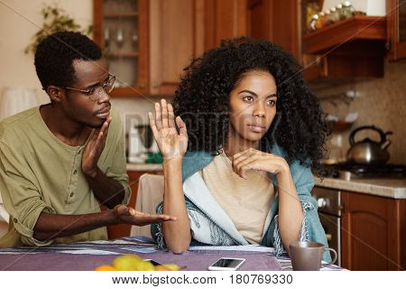 Regretful Guilty Young Afro-american Man In Glasses Offering Hand To His Angry Girlfriend As A Sign