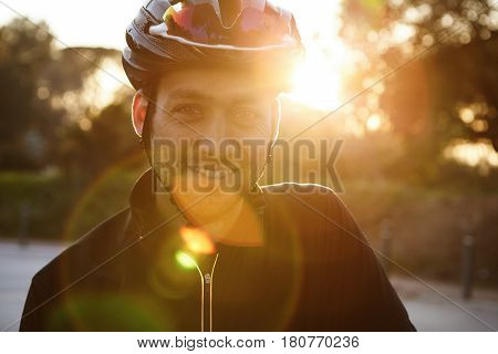 Close Up Shot Of Happy Attractive Young European Man With Beard Wearing Protective Helmet And Black
