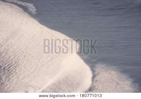 background of fresh snow covered on ground in winter, selective focus shallow depth of field