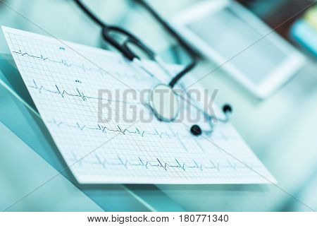 stethoscope and electrocardiogram on the table from the therapist.the photo is a blank space for your text