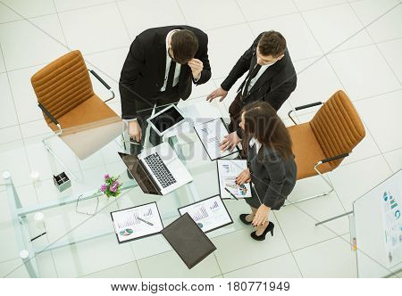 top view of successful business team working with financial graphs and discusses the profit of the company in a modern office