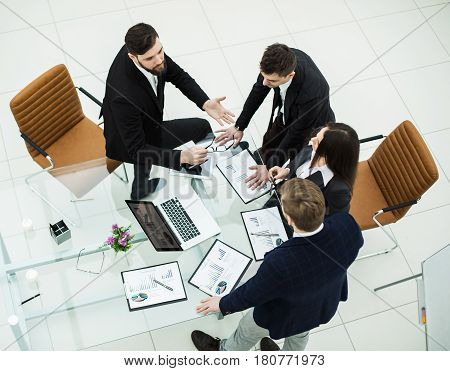 top view of successful business team discussing marketing graphics at the workshop meeting in a modern office .the photo has a empty space for your text.
