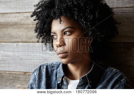 Sad Beautiful Dark-skinned Girl Wearing Denim Shirt Looking Away With Serious Expression On Face Fee