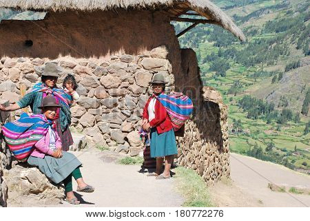 Pisac, Peru April 2016 Portrait of three local women dressed in traditional clothing in Pisac in the Urubamba valley near Cusco, Peru
