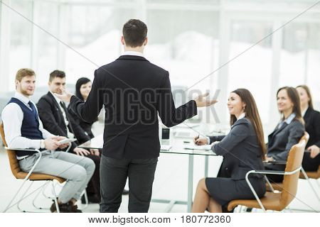 CEO speaks at the workshop business team in a modern office. the photo has a empty space for your text.