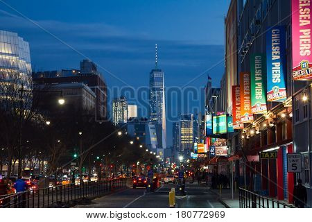 NEW YORK CITY - FEBRUARY 18th 2017: Traffic begins to backup along the West Side Highway on a busy night in front of the colorful signs of Chelsea Piers in Manhattan NYC on February 18th 2017.