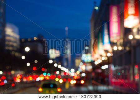 Blurred night lights of Manhattan street scene near Chelsea Piers in New York City NYC