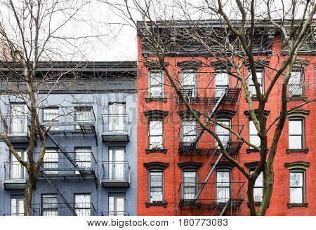 Blue and Red vintage style apartment buildings in the East Village neighborhood of Manhattan in New York City NYC