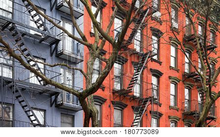Blue and Red old vintage brick apartment buildings in the East Village neighborhood of Manhattan in New York City NYC