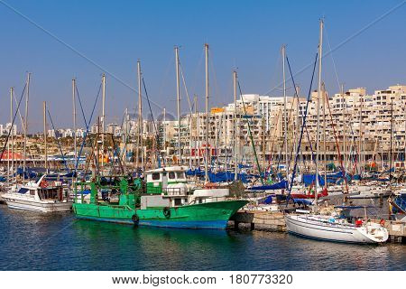 Yachts and boats anchored on marina in Ashkelon - coastal city on Mediterranean sea in Israel.