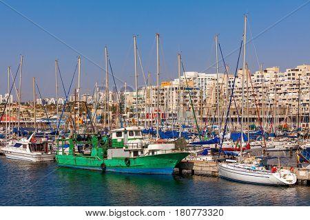 Yachts and boats anchored on marina in Ashkelon - coastal city on Mediterranean sea in Israel.