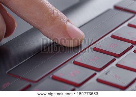 Finger Pushing Space Bar Button On Laptop Keyboard