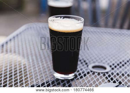 Full Pint Glass With Dark Beer