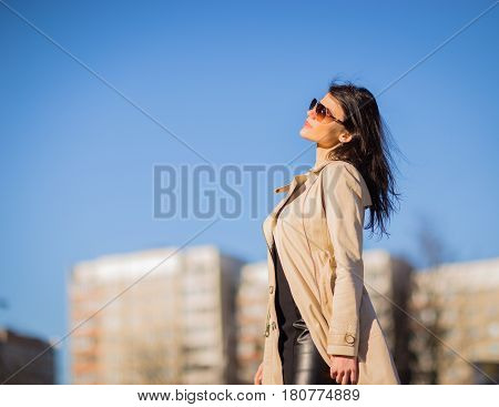 confident business woman on the background of blue sky in the city.the photo has a empty space for your text