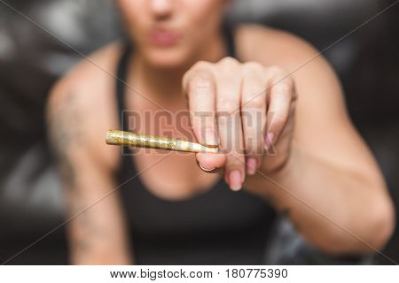 Rolled Joint In Woman's Hand