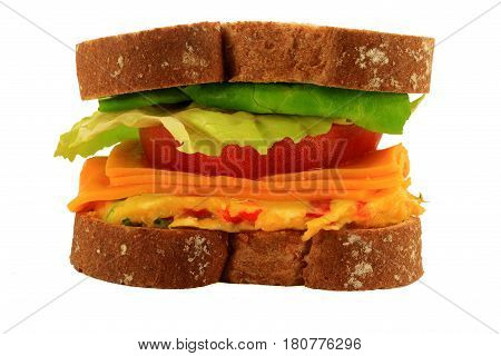 Picture of sandwich made from whole wheat bread vegetable omelet slices of cheddar cheese and tomato lettuce leaves over white background