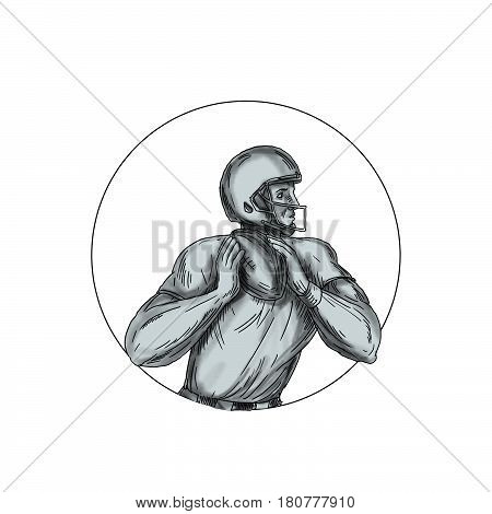 Tattoo style illustration of an american football gridiron quarterback qb player throwing football viewed from the side set inside circle on isolated background.