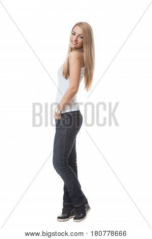 Beautiful young blond woman in white shirt and jeans standing on white background. Isolated. Copy space..