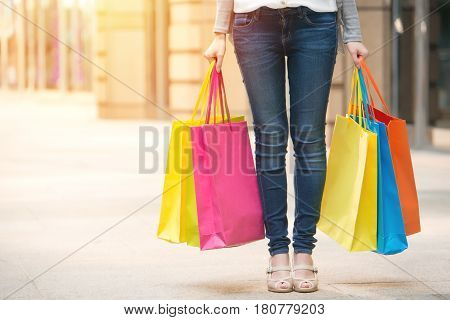 Woman Standing And Holding Shopping Color Paper Bags