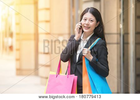 Shopping Woman Using Smartphone In City