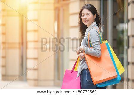 Shopping Woman Happy And Looking At Camera