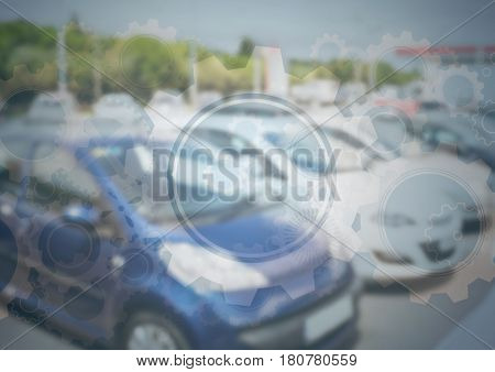 Digital composite of Cars in carpark with gear graphic overlay