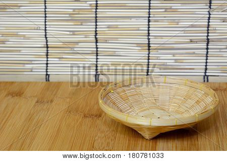 Closeup for empty bamboo basket on bamboo table