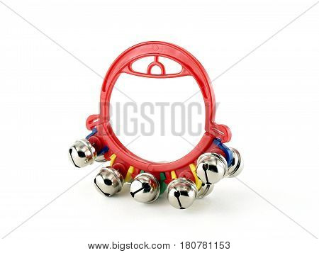 toy tambourine with small bell isolated on white background, music instrument for kids