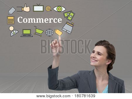 Digital composite of Businesswoman touching Commerce text with drawings graphics