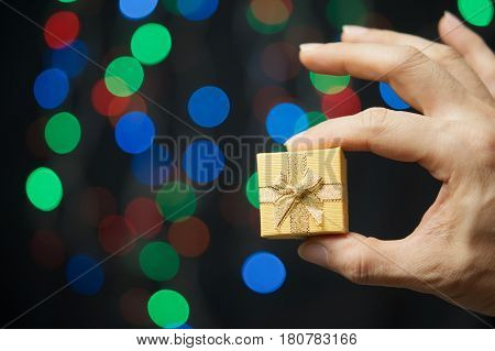 Hand Of Man Pinch Present Have Bokeh As Background