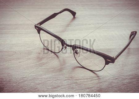 Eyeglasses Glasses With Black Frame Fashion Vintage Style On Wood Desk Background