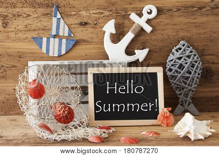 Blackboard With Nautical Summer Decoration And Wooden Background. English Text Hello Summer. Fish, Anchor, Shells And Fishnet For Maritime Contex.