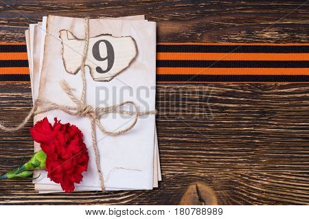 George ribbon on the blackboard under letters and a red flower